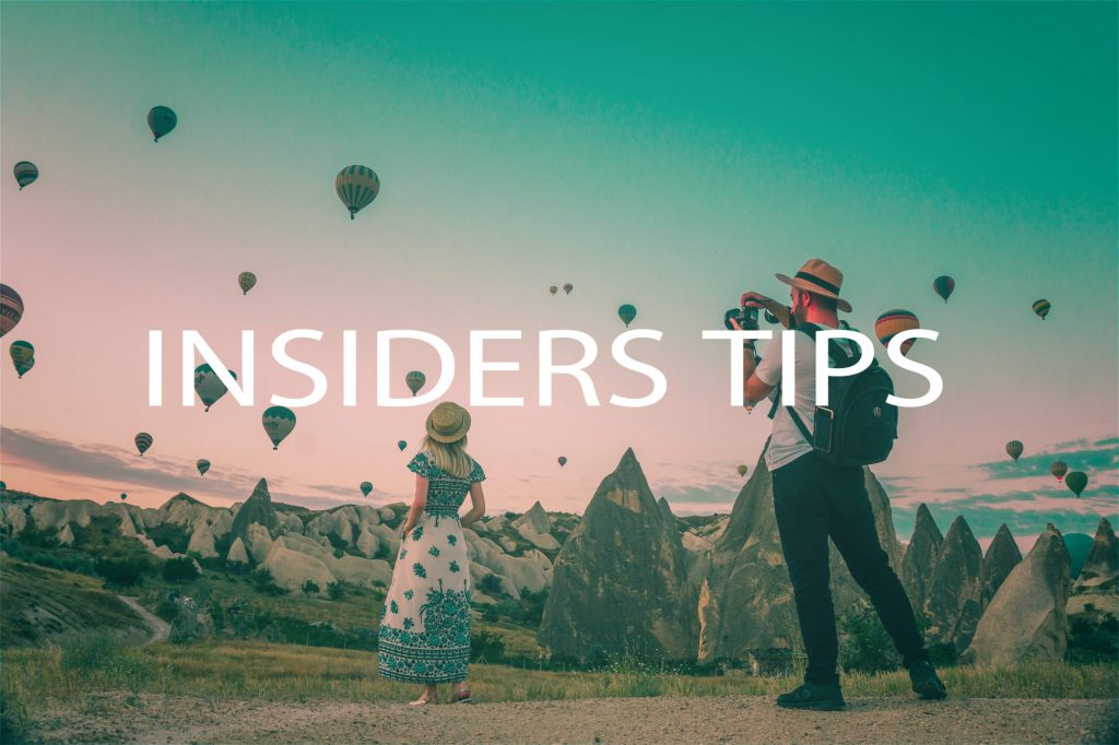Picture of couple looking at hot air balloons - click for insders' tips